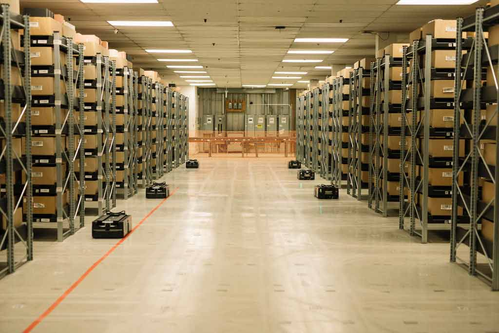 CAJA Robots operating in a warehouse.