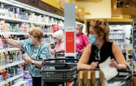 Simbe Tally robot operates in a crowded grocery store